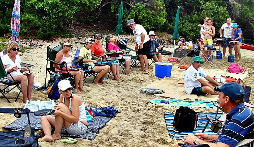 Friends picnic together at Monkey Beach on New Year's Day
