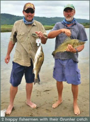 Two happy fishermen with their catch of Grunter.
