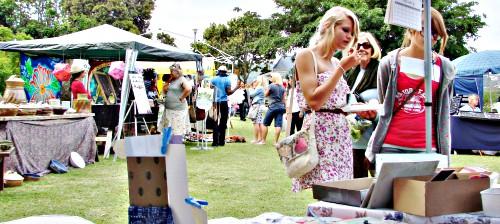 People enjoying the abundant stalls of the outdoor Leisure Isle Spring Festival