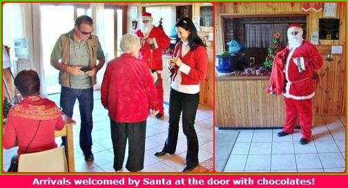 Santa welcomes everyone with chocolates