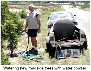 Watering newly planted trees