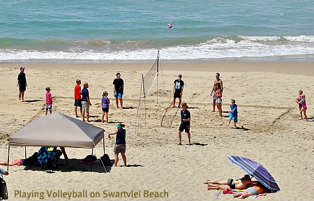 playing volleyball on Swartvlei beac